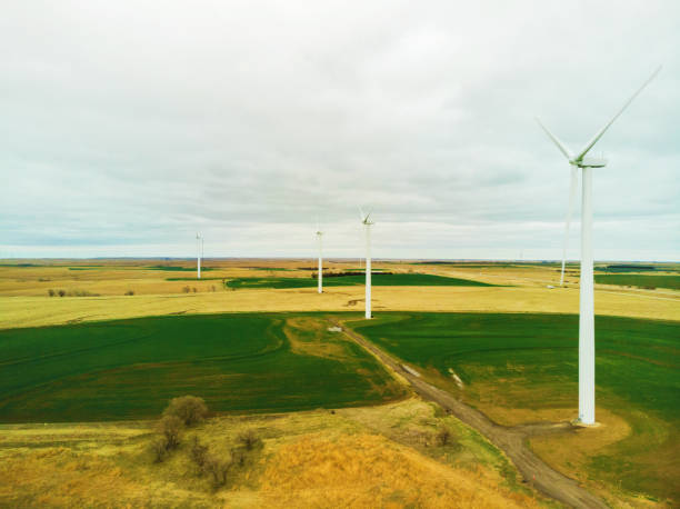 Wind Energy Turbines on a Cloudy Late Winter Day in Kansas Midwest USA In Kansas Wind Energy Turbines on a Cloudy Late Winter Day in Kansas Midwest USA Matching 4K Video Available (Shot with DJI Mavic Air 12mp 4032×3024 photos professionally retouched - Lightroom / Photoshop) eyecrave stock pictures, royalty-free photos & images
