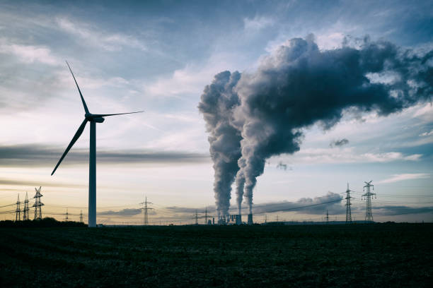 Wind energy versus coal fired power plant stock photo