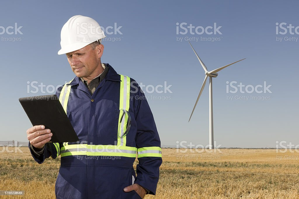 Wind Energy Worker and Tablet royalty-free stock photo