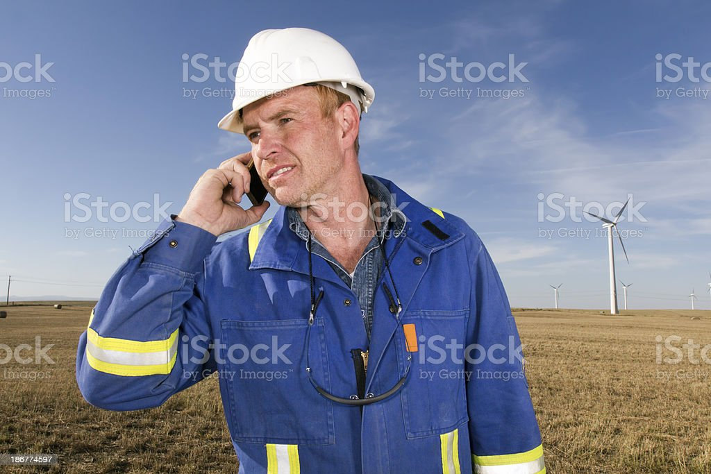 Wind Energy Worker on the Phone royalty-free stock photo
