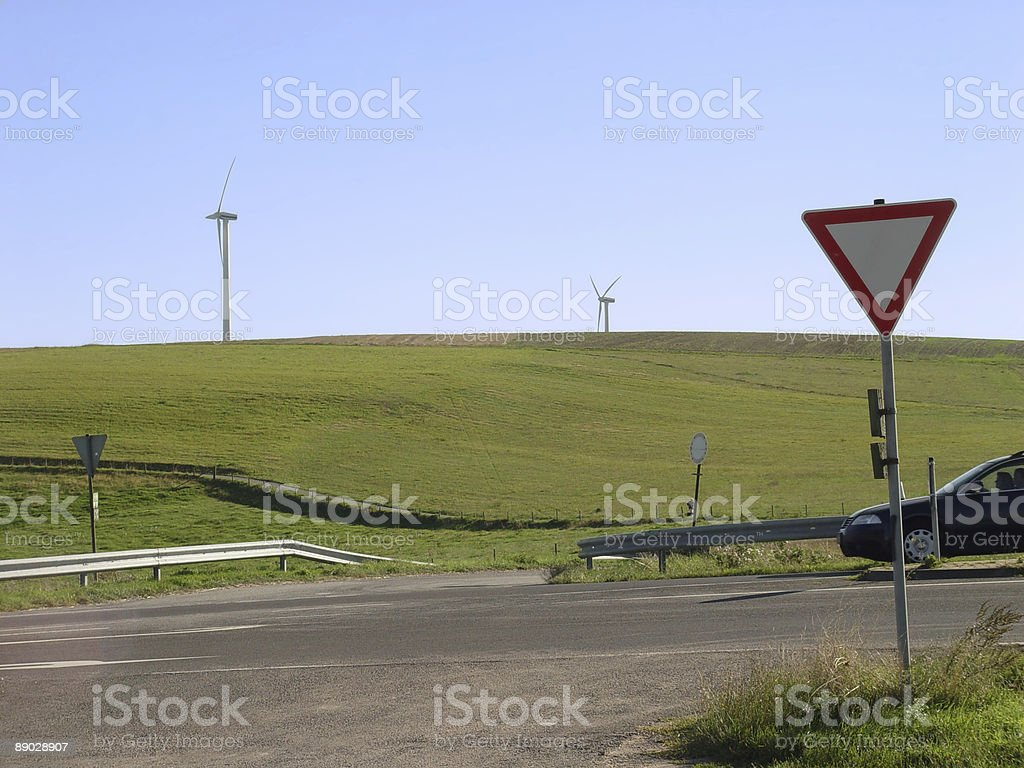 Wind Farm and Yield Sign (with car) royalty-free stock photo