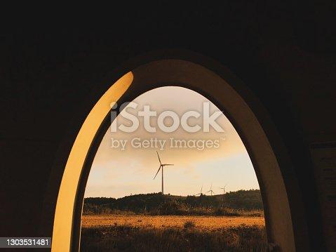 istock Wind farm at sunrise. Renewable energy concept. 1303531481