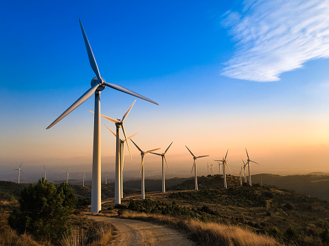 Wind farm in Navarre, Spain at sunset. Renewable energy concept.