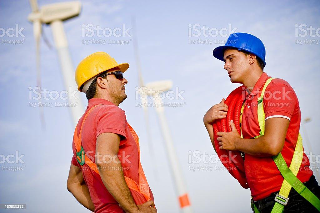 Wind farm employees royalty-free stock photo