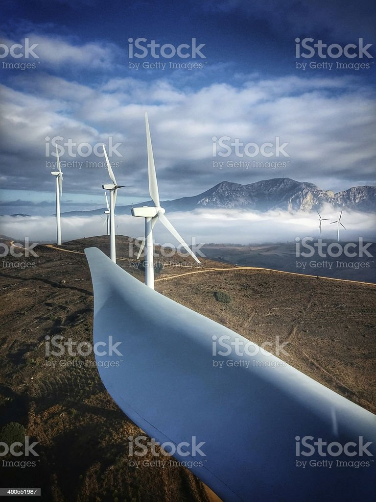 Wind farm from the top of a windturbine. stock photo