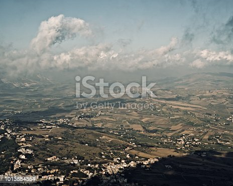A small group of wind turbines can be seen in this panorama of the province of Trapani, Sicily, seen from Erice