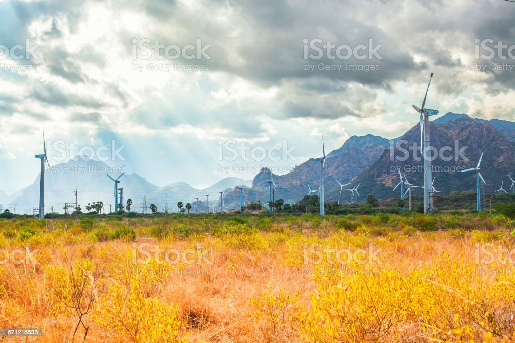 Wind farms in the lowlands near the mountains stock photo