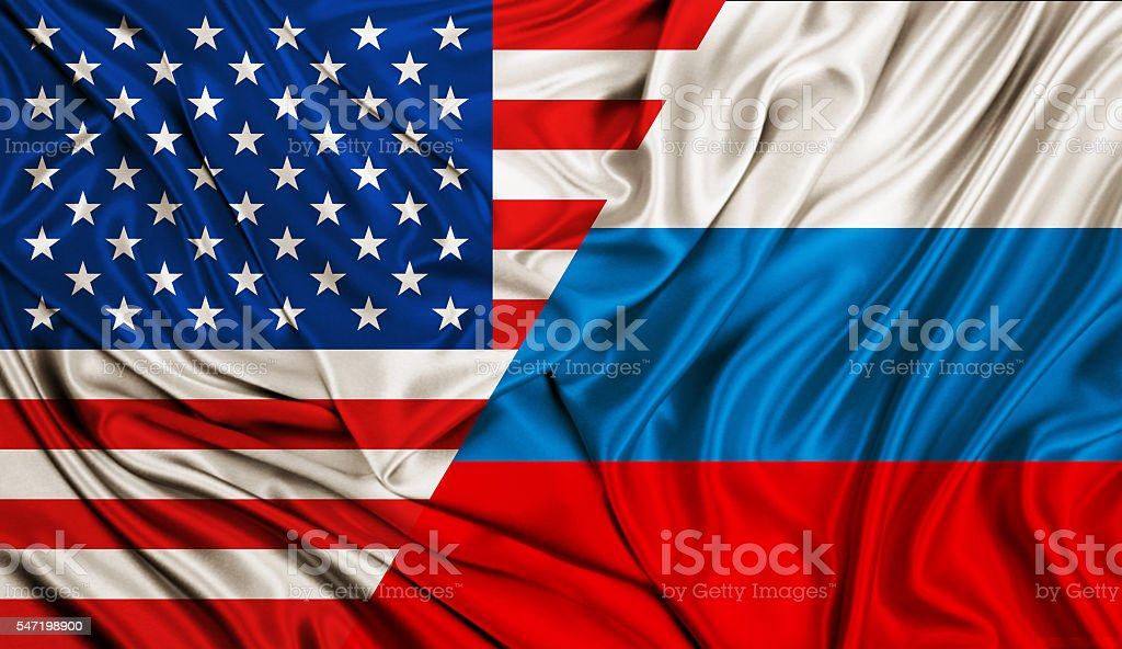 Wind flag - USA and Russia stock photo