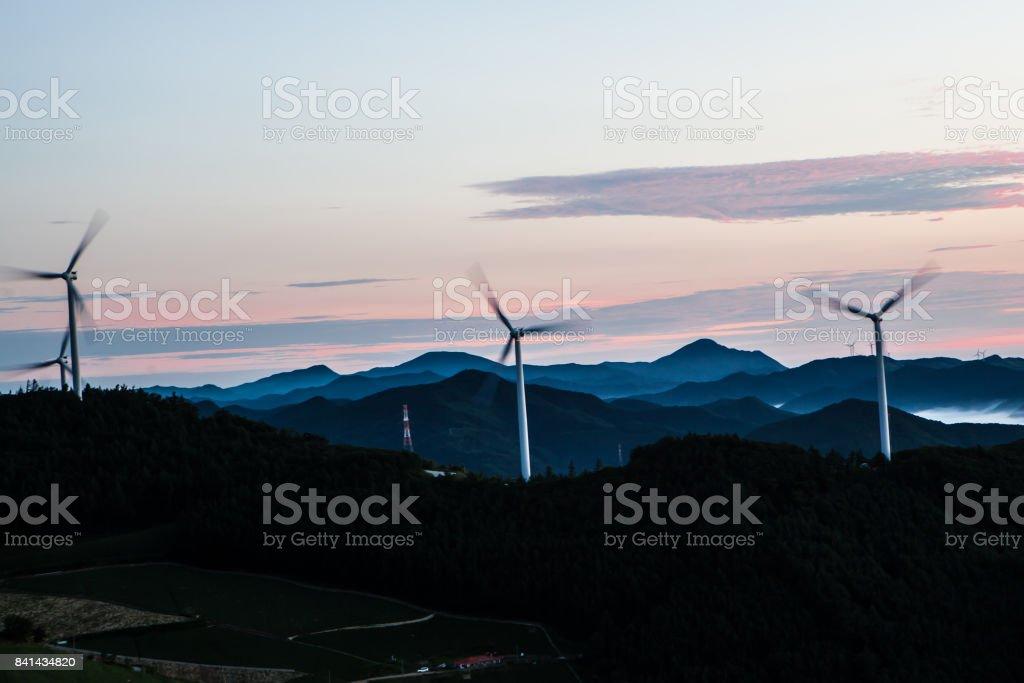 Wind generator and mountain stock photo