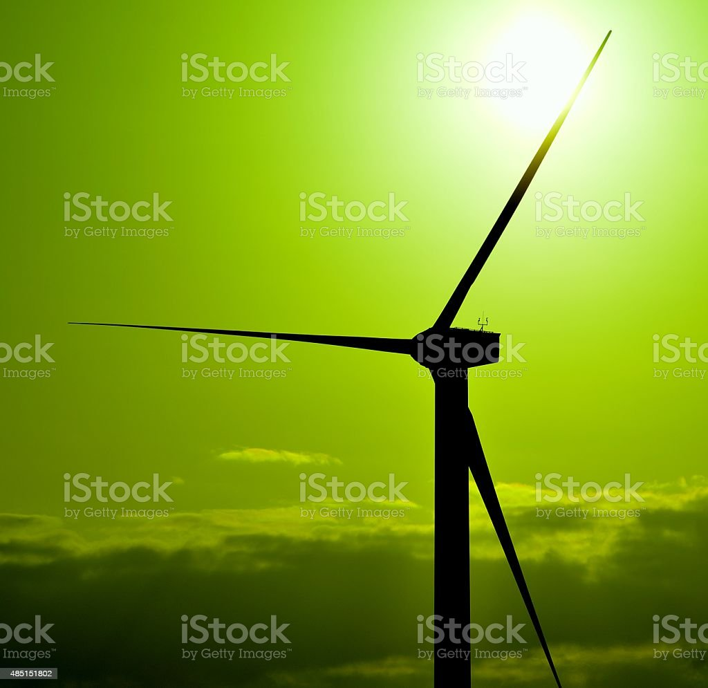 Wind Generator At Sunrise With Green Color Effects Stock