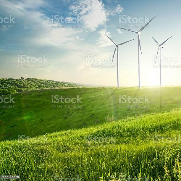 Photo of Wind generator turbine on summer landscape