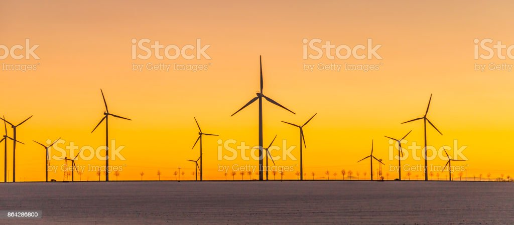 wind generators in sunset royalty-free stock photo