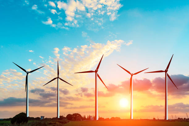 wind generators scene at sunset wind generators under blue sky on sunset wind power stock pictures, royalty-free photos & images