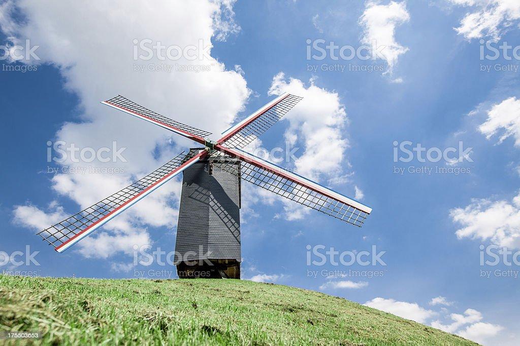Wind mill in empty field stock photo