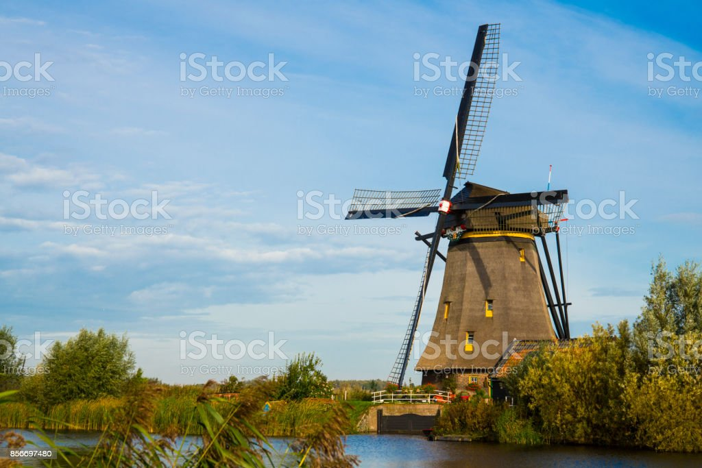 wind mill, Unesco, in water landscape Kinderdijk, The Netherlands stock photo