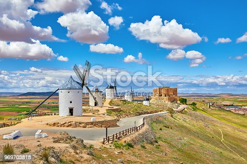 istock Wind mills and vintage fortress in Consuegra 969703818