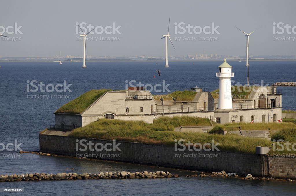 Wind power and Lighthouse stock photo