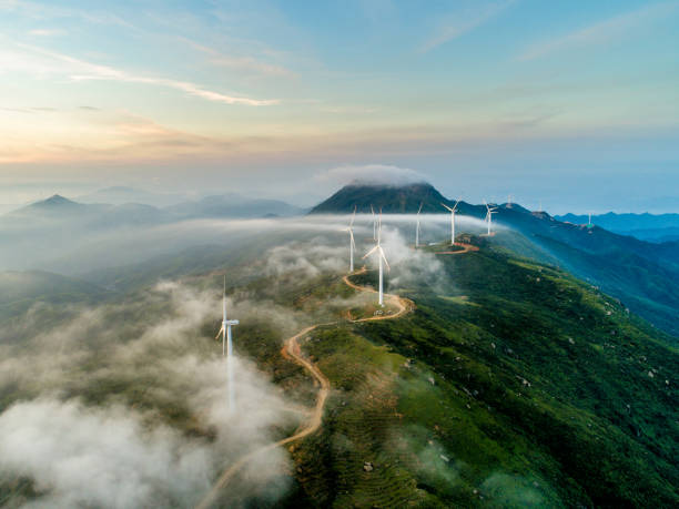 Wind power generation The wind field of the mountain ridge. High angle aerial photography. windmill stock pictures, royalty-free photos & images