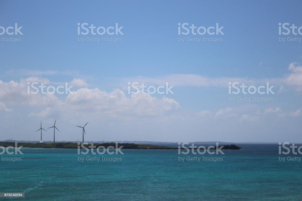 Wind power generators on coral islands in the middle of the ocean. in Miyako island, Okinawa, Japan. stock photo