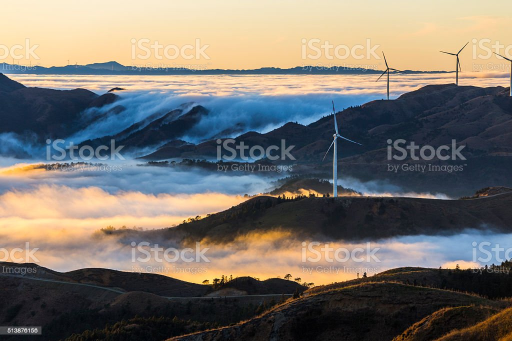 Wind Power in the sea of clouds,Guilin,China Wind Power in the sea of clouds,Guilin,China Aerial View Stock Photo