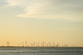 Wind turbines on a very nice beach and sunset
