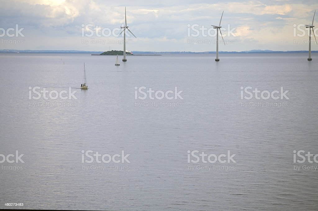 Wind power plant and a ship stock photo