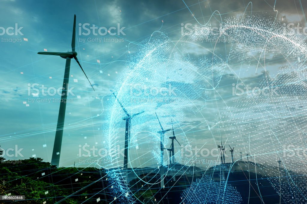 Wind power station and global communication concept. stock photo