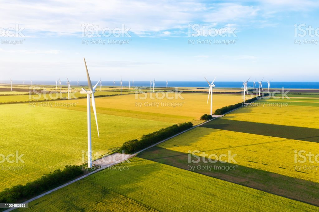 Wind power station on the field. Aerial view from drone. Concept and...