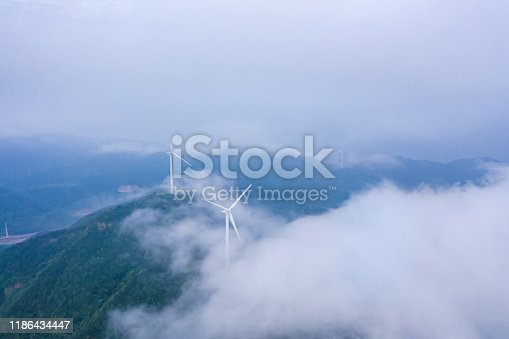 892160114 istock photo Wind power station on the mountain 1186434447