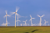 wind power turbines on a hill in morning. Dobrogea, Romania