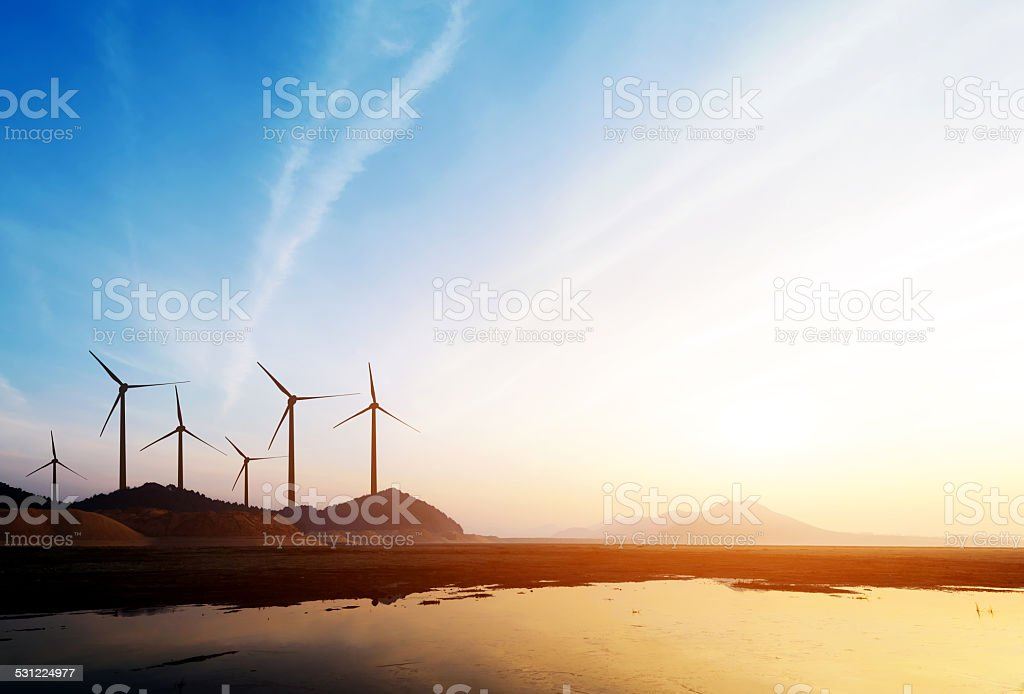 Wind power turbines stock photo
