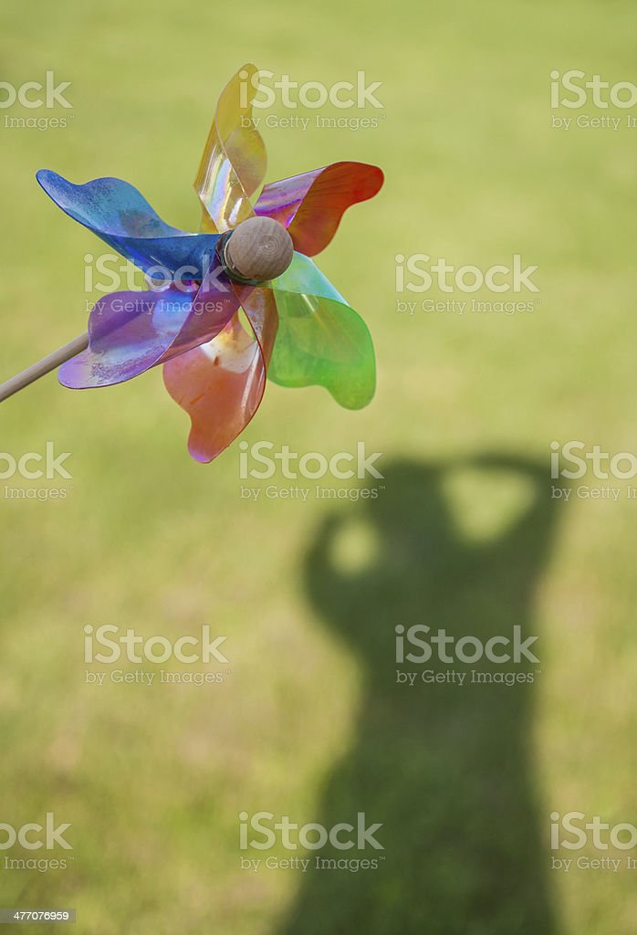 wind rose (pinwheel) and shadow of a person royalty-free stock photo