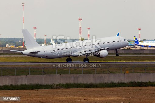 istock UR-WRT Wind Rose Aviation Airbus A321-200 aircraft landing on the runway 973739832