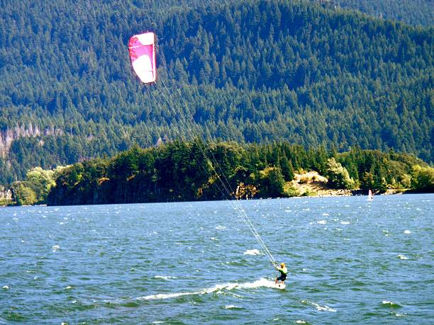 Wind Sail Surfing Kiteboarding in Columbia River Gorge Kiteboarding Wind Sail Surfing in Columbia River Gorge Oregon Washington Surf hood river valley stock pictures, royalty-free photos & images