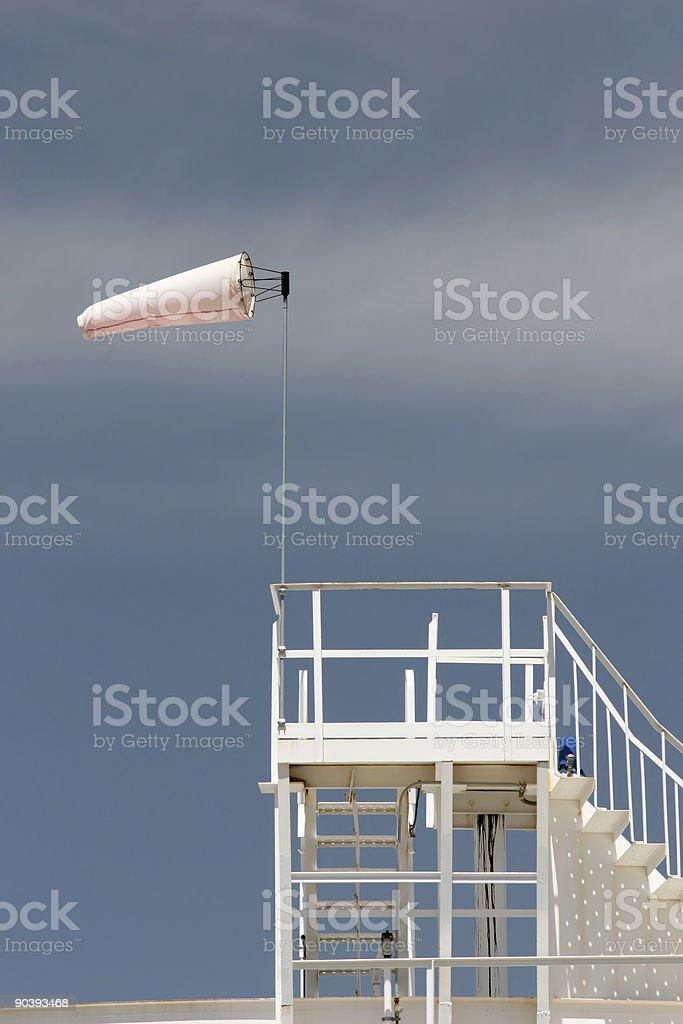 wind sock on oil storage tank royalty-free stock photo
