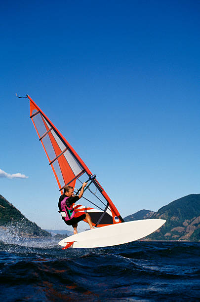 Wind Surfer on Columbia River Wind Surfer Jumping on Columbia River near Hood River, Oregon hood river valley stock pictures, royalty-free photos & images