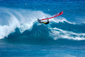 Single Wind Surfer Riding The Crest of A  Good Wave.