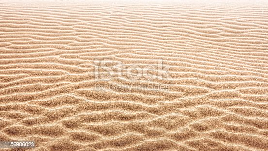 Wind traces on fine sand lines Background / Copy space