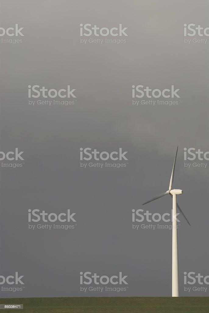 WInd turbine against a dark sky royalty-free stock photo