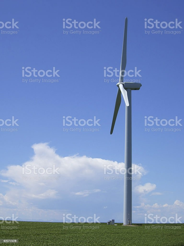 Wind turbine against prairie sky and thunderstorm royalty-free stock photo
