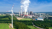 Wind turbine and coal power station - fuel and power generation in the past and nowadays. Aerial view