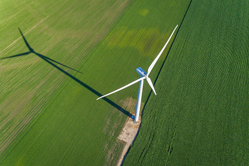 istock Wind turbine and countryside corn field. Top view 812587438