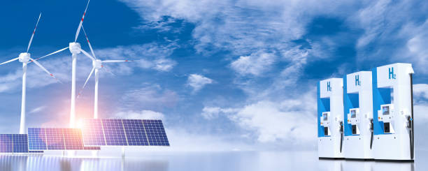 Wind turbine and solar panels on blue sunny sky with some clouds. green alternative energy concept. stock photo