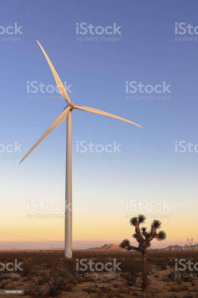 Wind turbine at sunset stock photo