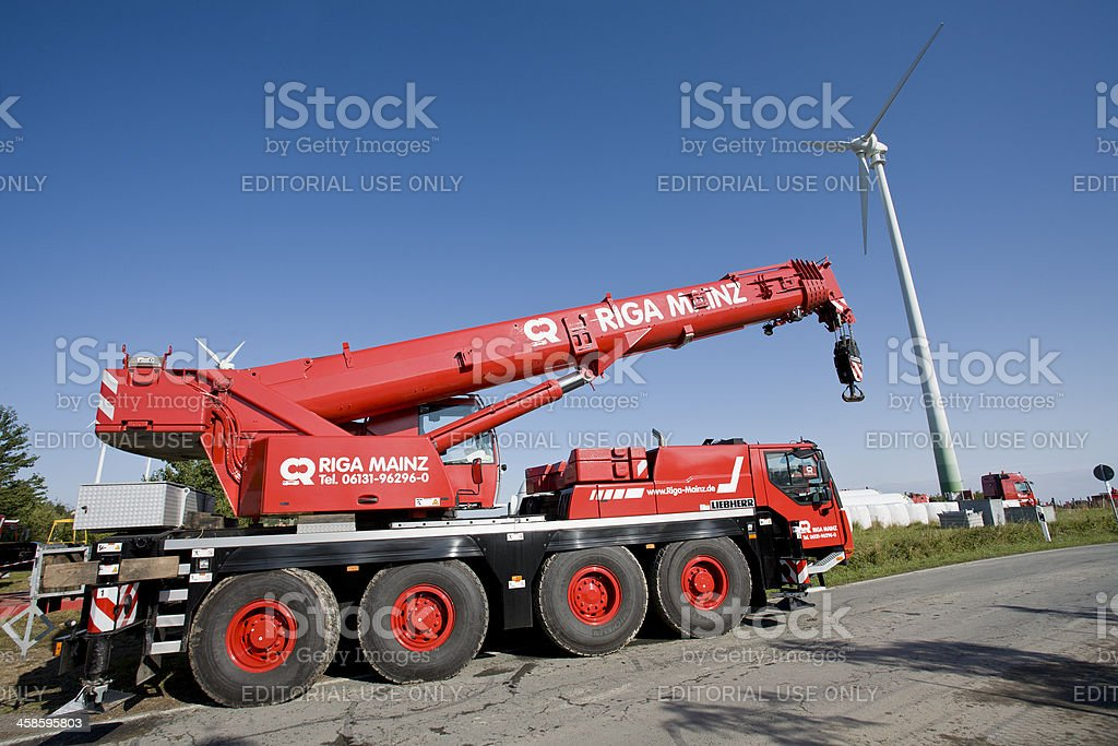 Wind turbine construction site, large crane royalty-free stock photo