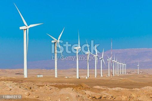 istock Wind turbine farm - renewable, sustainable and alternative energy 1155412112