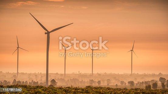 892160114 istock photo Wind Turbine field on sunset sunrise nature ,wind power and Alternative Energy concept.Energy windmills power electricity 1157951340