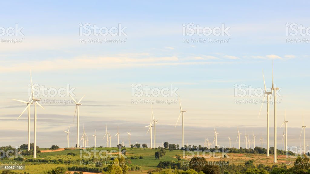 Wind turbine field on the hill for renewable energy source. stock photo