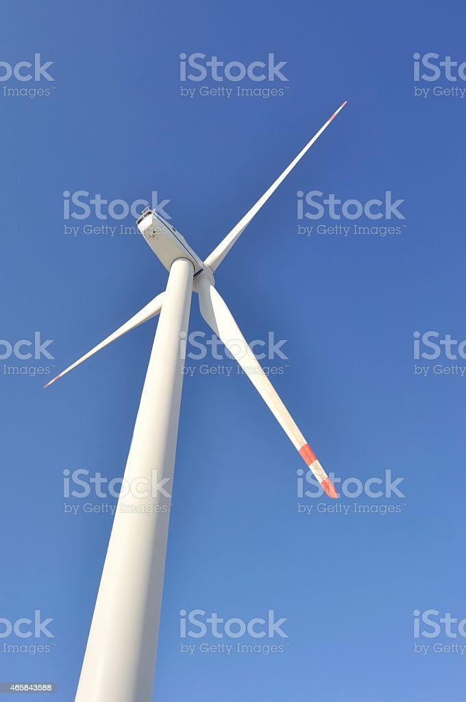 Wind Turbine for alternative energy on background sky stock photo