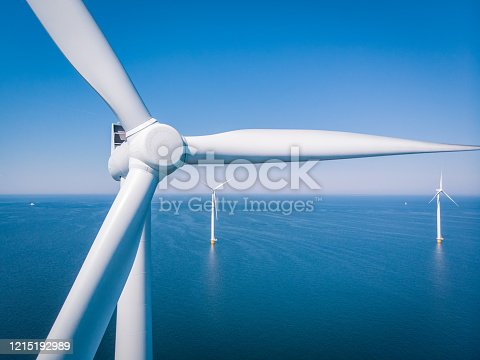 istock Wind turbine from aerial view, Drone view at windpark westermeerdijk a windmill farm in the lake IJsselmeer the biggest in the Netherlands,Sustainable development, renewable energy 1215192989